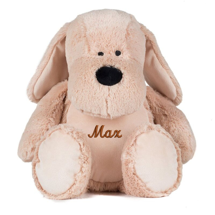 Mid Brown coloured soft plush dog. Floppy ears. Sewn eyes. Contrast brown nose. Light Brown coloured panel on chest and feet. Complies with EN71 European Toy Safety regulations. Remove all hang tags and their fasteners before giving these items to a child. Suitable for all ages.
